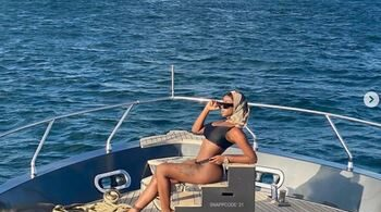 Khloe Shows Off Banging Body As She Poses On A Yacht (Photos)